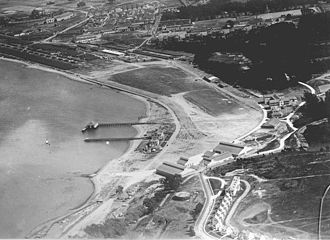 Crissy Field - Aerial view of Crissy Field 1922-23, hangars and quarters in lower center. The H-shaped building at right center is the enlisted barracks.