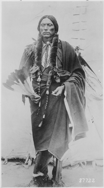 Quanah Parker, a Kwahadi Comanche chief, full-length, standing in front of tent - NARA - 530911.tif