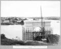 Queensland State Archives 3484 North main pier concrete surface being rubbed down and falsework removed Brisbane 28 February 1937.png
