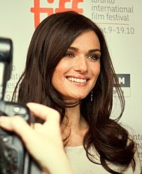 Smiling young woman with long dark hair