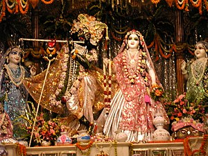 Radha Krishna - Radha (right) - Krishna (left), surrounded by gopis, in Mayapur Chandradoya Mandir, 2005
