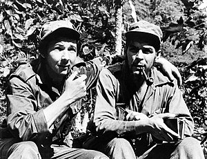 "Cuban Revolution - Raúl Castro (left), with his arm around his second-in-command, Ernesto ""Che"" Guevara, in their Sierra de Cristal mountain stronghold in Oriente Province, Cuba, in 1958"