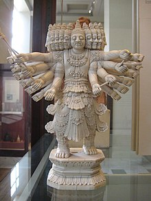 A statue of Ravana with several heads and over a dozen arms