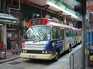 Red minibus (aka maxicab) on Jardine's Bazaar,...