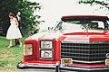 Red car at wedding in London (Unsplash).jpg