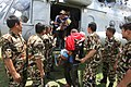 Rescued persons including children are being de-boarded to a safer place by IAF Mi-17 helicopter in the quake hit Nepal.jpg