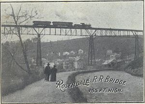 "Rosendale Trestle - A depiction of two women walking under the trestle, in the area known as ""Dead Man's Stretch"""
