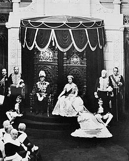 George VI, King of Canada, and his consort, Elizabeth, occupy the thrones in the Senate, while the King grants Royal Assent to laws, May 19, 1939.