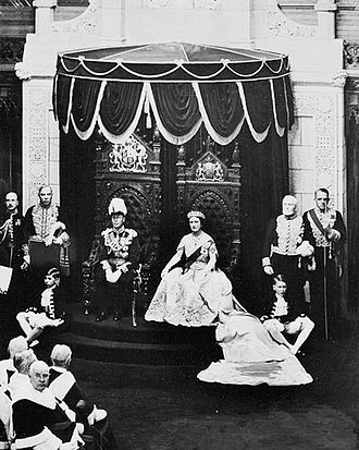 Queen-in-Parliament - King George VI, accompanied by Queen Elizabeth, grants royal assent to laws in the Canadian Senate, 19 May 1939