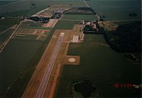 Runway 28 of Lolland Falster Airport seen from under a parachute.jpg