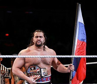 Rusev (wrestler) - Rusev displaying the United States Championship and Russian flag in February 2015.