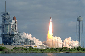 STS-31 - Space Shuttle Discovery launches into the sky at the start of STS-31, while, for the first time since 1986, a second shuttle, Columbia, waits for her chance to launch.