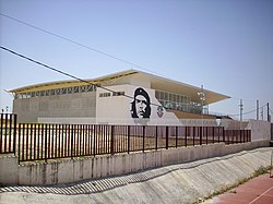 The multi purpose building of Marinaleda, also used as town hall, adorned with a portrait of Ernesto Che Guevara