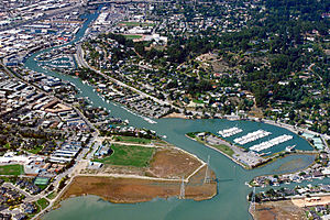 Canal Area, San Rafael, California - Aerial view of the San Rafael Canal, looking west.  The northern tip of the Canal Area is on the left, with Pickleweed Park in the central foreground.