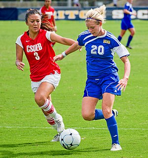 California State University, East Bay - A CSUEB soccer player attempting to take the ball from a University of California, San Diego attacker