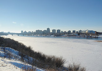 Saskatoon - Winter skyline of Saskatoon with the South Saskatchewan River bisecting the city. Winters in the city are long, and cold.