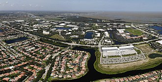 Sunrise, Florida - Panoramic aerial view of Sawgrass Corporate Parkway in Sunrise, FL and American Express. The Everglades are also shown in the back and a residential area facing Parkway.