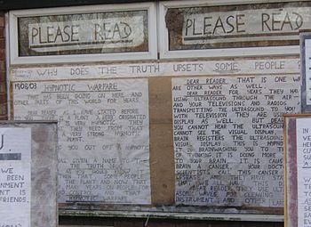 Messages covering the windows of a house from ...