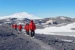 Secretary Kerry Walks Along Volcanic Rock Near the hut in Cape Royds, Antarctica (30913580985).jpg