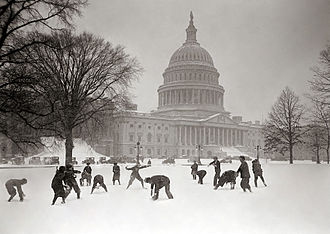 Page of the United States Senate - Senate Pages having a snowball fight in front of the Capitol, ca. 1925