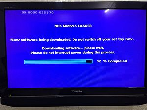 Set-top box - Set-top box firmware being updated
