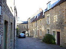 Narrow street between stone houses