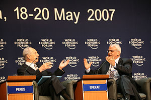 Shimon Peres, Saeb Erekat captured at a sessio...