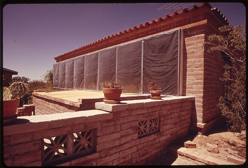 File:Side of a home near Tucson, Arizona has blackened panels under the plastic sheeting which heat circulating air..., 04-1974 (6919925018).jpg
