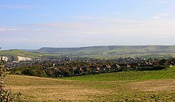 Modern photograph of the site of the Battle of Lewes 1264. The battle was fought between Simon de Montfort and Henry III in the field in the foreground with the former being victorious. Lewes castle and Southerham chalk pits to the left and Beddingham Hill behind it with the town of Lewes.