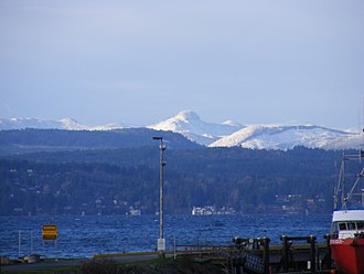 Vancouver Island Ranges - This subrange, not named on official maps, lies east of the San Juan River on southern Vancouver Island and forms the horizon in this west-facing view looking across Patricia Bay from North Saanich.