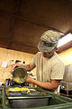 Soldiers prepare food 120821-A-PO167-046.jpg