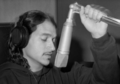 "Songwriter-vocalist Ithaka Darin Pappas recording the demo of his hit song ""Seabra Is Mad"" in Lisbon, Portugal 1996.png"
