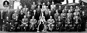 A formative photograph of about 30 politicians, standing and sitting in four rows