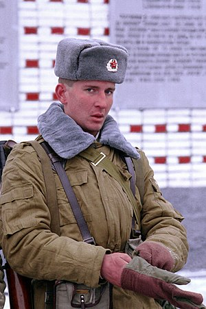 Soviet Army - A Soviet soldier of the 2nd Guards Tamanskaya Motor Rifle Division wearing the winter Afghanka uniform, Moscow, January 1992