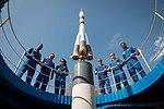Soyuz MS-15 prime and backup crews at the Soyuz rocket monument behind the Cosmonaut Hotel.jpg
