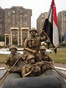 Statue of heroic Egyptian soldiers crossing the Suez canal.jpg