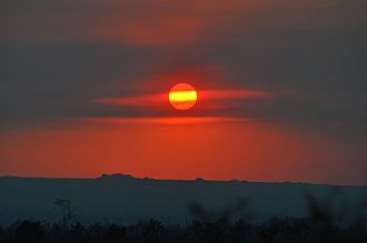 Haze - Haze over the Mojave Desert from a brush fire in Santa Barbara, California, seen as the Sun descends on the 2016 June solstice, allows the Sun to be photographed without a filter.