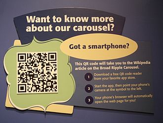 The Children's Museum of Indianapolis - Label using a QRpedia code to direct visitors to the Wikipedia article Broad Ripple Park Carousel.