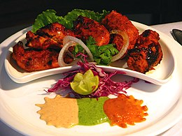 Chicken tikka servito a  Bombay in India.