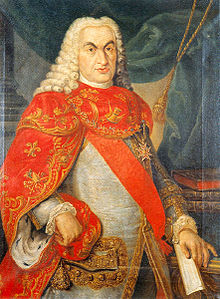 An elderly brown-eyed man wears a powdered periwig and a red sash, with, over this, the cross of the Constantinian Order of Saint George.