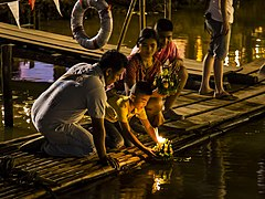 Thai people setting their candle-lit krathongs in the Ping river at night during Loy Krathong 2015-10 (22715933524).jpg