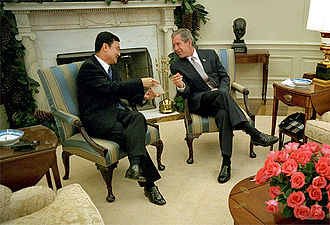Thailand–United States relations - U.S. President George W. Bush meets with Prime Minister Thaksin Shinawatra of Thailand in the Oval Office Dec. 14, 2001. The two leaders discussed economic issues and the war on terrorism