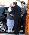 The Prime Minister, Shri Narendra Modi being received by the President of Tajikistan, Mr. Emomali Rahmon, on his arrival, at the Qasr-e-Millat, in Dushanbe, Tajikistan on July 13, 2015.jpg