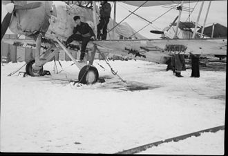 Merchant aircraft carrier - Members of the air party and two Swordfish aircraft on the snow-covered flight deck of M/V Ancylus.