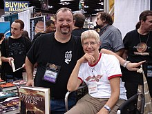 Margaret Weis (seated) with Tracy Hickman at Gen Con Indy 2008
