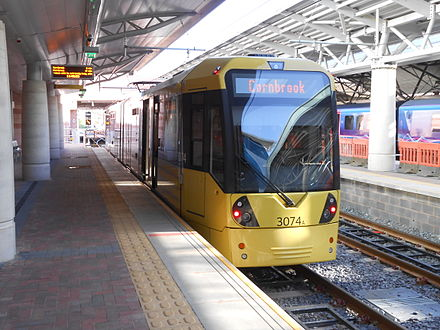 A tram at Manchester Airport in November 2014 shortly after the line opened. Tram 3074 at Manchester Airport Metrolink station.jpg