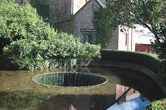 River Otter, Devon -  Known as the Tumbling Weir, at Ottery St Mary, water flows inwards over concentric circles, returning to the river via an underground tunnel.