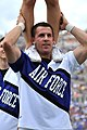 U.S. Air Force Academy Falcons cheer team member David Shealy performs for the crowd during the Falcons football game against the Idaho State Bengals at Falcon Stadium in Colorado Springs, Colo., Sept 120901-F-WR679-864.jpg