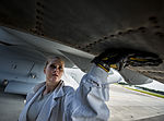 U.S. Air Force Staff Sgt. Jennifer Smith, a jet propulsion specialist with the 437th Maintenance Group, runs her hand along the bottom of a C-17 Globemaster III aircraft engine to inspect for cracks, bumps 130626-F-LR006-007.jpg