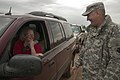 U.S. Army Brig. Gen. Robbie Asher, right, the director of the Joint Staff, Oklahoma National Guard, talks with Susan McClintock, a former Soldier with the Oklahoma Army National Guard, May 21, 2013, in Moore 130521-Z-RH707-035.jpg